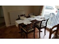Dining table and 4 chairs good condition excellent as is or as a paint project