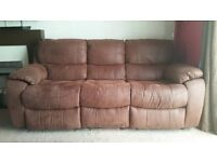 2 reclining faux suede sofas. Really good condition .