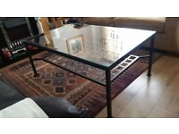LARGE METAL GLASS COFFEE TABLE WITH LATTICED METAL UNDERSHELF . LOVELY STATEMENT PIECE