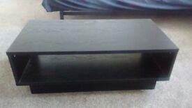 Black coffee table with 1 shelf