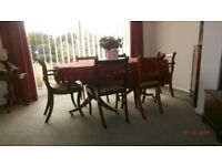 Dining room table two carver chairs and 4 chairs