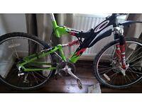2x bikes (CARRERA BANSHEE MOUNTAIN BIKE) & (TRAX BMX STUNT BIKE)
