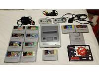 SNES (Super Nintendo) with games