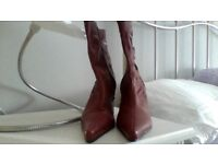 Ladies red/burgundy ankle boots, ruched detail with side zips. Stiletto heel and pointed toe.