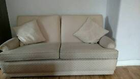 Three armchairs, one three seats sofa and one foot stool.