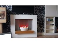 electric fireplace with wooden surround with ceramic bowl