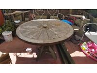 Cart wheel table and 3 chairs. Handmade and table top and chairs spin.