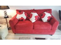 RED 2 SEATER SETTEE AS NEW