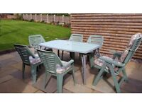 Glass Topped Patio Table and 6 chairs
