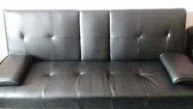 Black sofa bed with built in bluetooth speakers