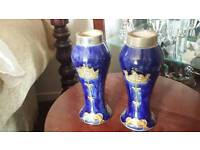 Pair of royal doulton vases in mint condition solid silver tops