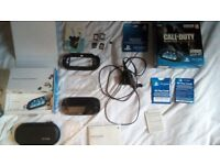 PS Vita Bundle with 3 Cases, 2 Memory Cards (4GB, 8GB) and Games (Boxed, Mint Condition)
