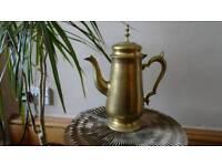 Antique gold old metal jug