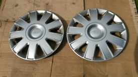 Ford hub caps wheel trims £6 ono for a pair of 15 inch spares.Genuine Parts. Excellent condition.
