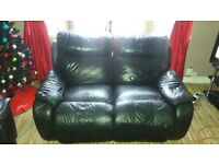 FREE TO GO ..2 seater black leather reclying sofa