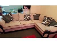 Large cream and black corner sofa