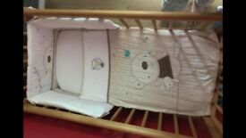 Crib and brand new bedding, sheets and bumper set.