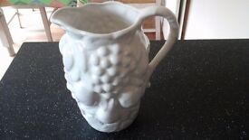 Large white jug embossed with fruits