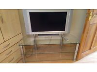 Silver television colour in perfect working order and 3 tier glass stand Bargain price.