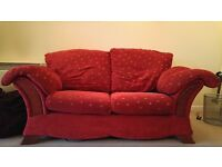 2 seater red DFS sofa