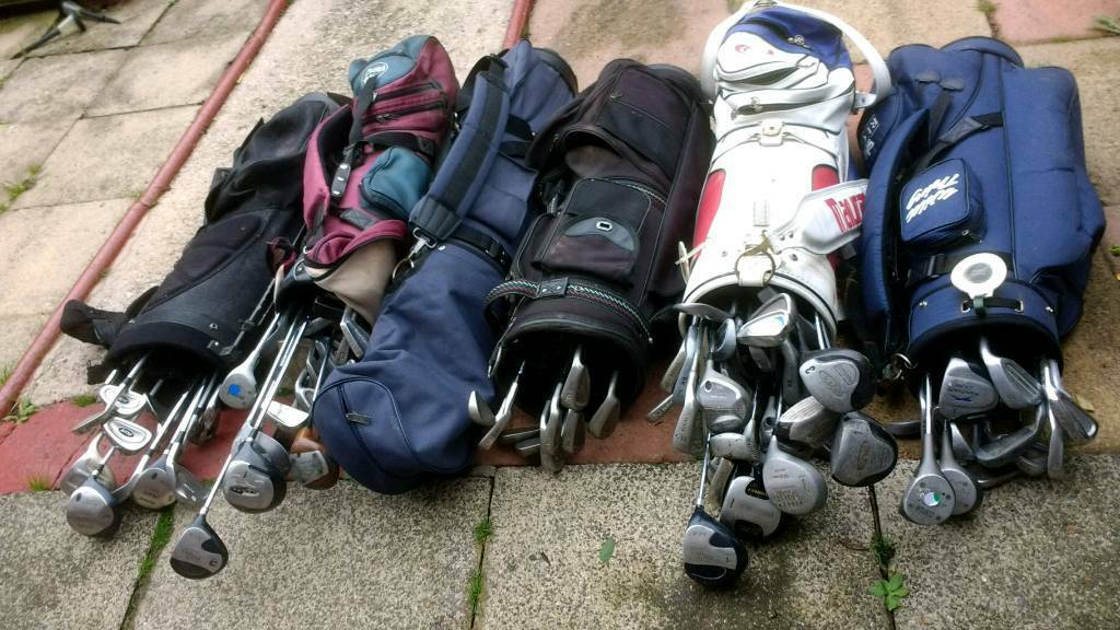 Job lot of golf clubs & bags.