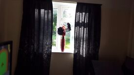 2 pair long black curtains with silver pattern and tie backs