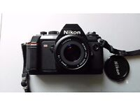 Nikon f 301 with 50 mm E lens.