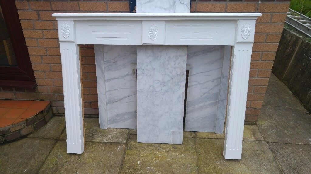 White wooden fire surround with marble back and hearth