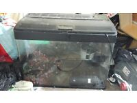 large fish tank. comes with pump but no heater. will need 2 strip lights. no cracks
