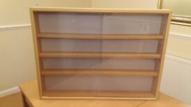 WOODEN DISPLAY CABINET WITH ADJUSTABLE SHELVES AND SLIDING GLASS DOORS