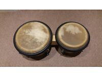 Nice bongos with natural animal skins and wooden frame.. Good condition.