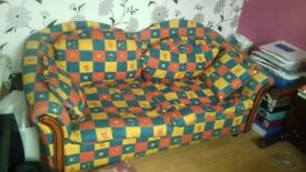Sofa bed . Bright cover metal action sofa bed in great condit