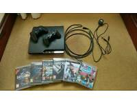 PS3 (slim 320gb) and 6 games