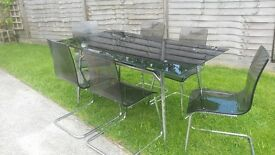 black tempered glass dinning table and 6 chairs