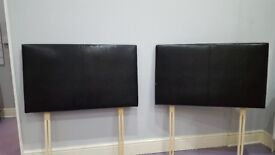 Two single faux leather headboards