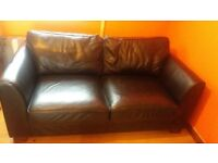 black leather like sofa and arm chair