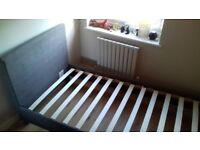 Almost new grey fabric single bed frame