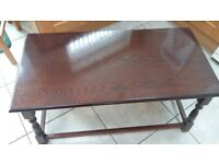 Dark wood coffee table in good condition