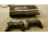 Sony PlayStation 3 with two controllers plus games