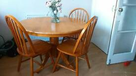 Pine round dining table and chairs