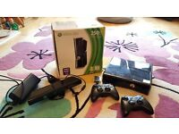 Xbox 360 console, two controllers and Kinnect