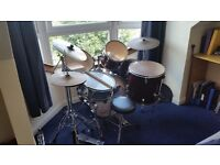Full sized adult drum kit includes silencers