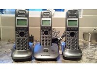 Set of 3 Panasonic portable phones.