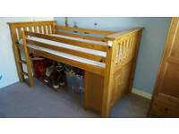 Single cabin bed with a storage unit