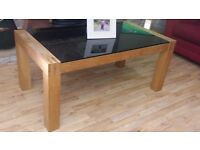 Dark glass topped coffee table . I can also arrange delivery if required.