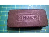 "Singer ""Black Tin"" of sewing machine accessories"
