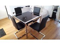Black glass extending table and 4 chairs