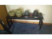 Full weights set, barbells, squat rack, bench press, dead lift, many kilos of weight