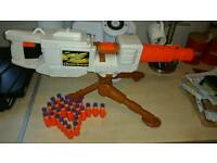 Standing Nerf gun and bullets