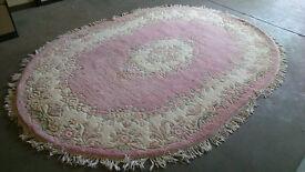 Large patterned oval rug